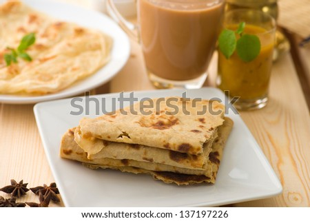 Chapati stacked, Indian flat bread in plate usually served with curry. Popular foods in Malaysia - stock photo