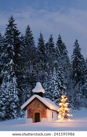 Chapel at Christmas with Christmas tree and snow-covered trees in the background, Elmau, Bavaria, Germany