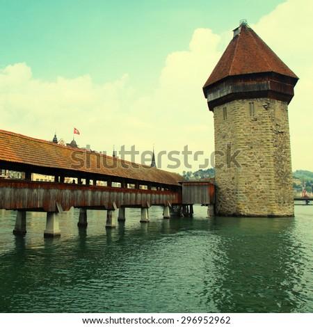 Chapel Bridge - famous landmark of Lucerne, Switzerland. Chapel Bridge is the oldest wooden bridge in Europe, originally built in 14th century. Square toned image, instagram effect - stock photo