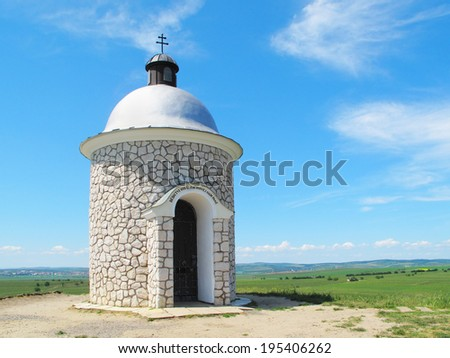 Chapel on the hill over vineyards. Beautiful landscape in South Moravia, Czech republic. - stock photo