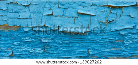 Chapped paint on an old wooden surface  - stock photo