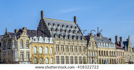 Characteristic Flemish high pitch roof lines in the main square of medieval Ypres (Ieper), Belgium - stock photo