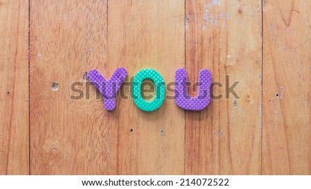 characters on wooden background - stock photo