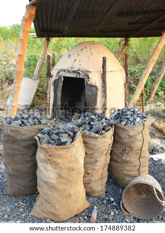 Charcoal and antique charcoal clay oven - stock photo