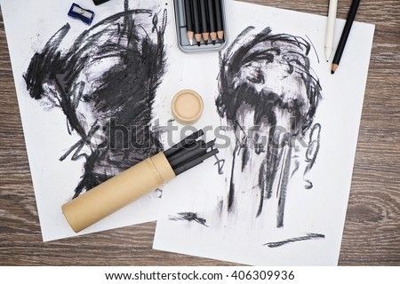 charcoal artworks on papers and charcoal painting equipment