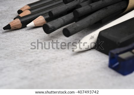Charcoal pencils, charcoal sticks and other equipment