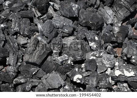 Charcoal pile - stock photo