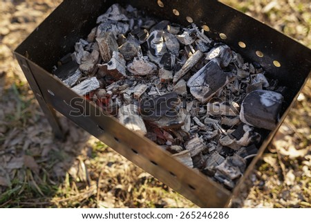 charcoal preparation for bbq in mangal - stock photo