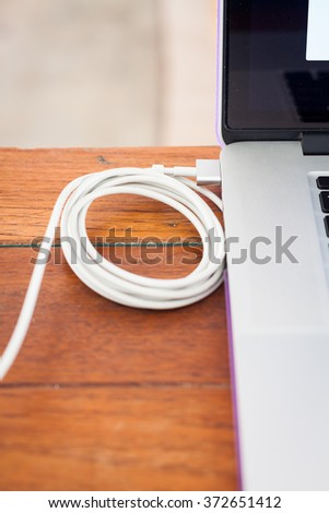 Charge battery laptop on work station, stock photo - stock photo