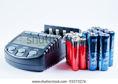 Charger with batterys - stock photo