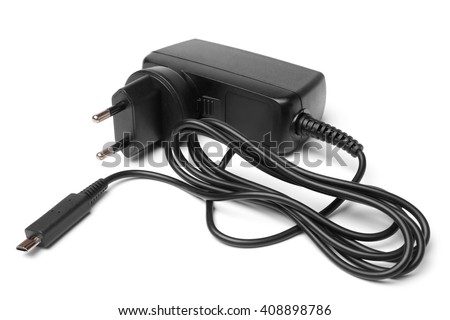 Charger with cable on white background - stock photo