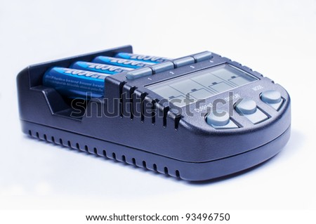 Charger with display charging batteries - stock photo