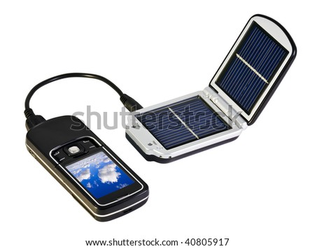 charges your mobile phone from the solar - stock photo