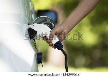 Charging battery of an electric car - stock photo