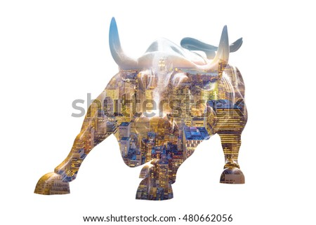 Charging Bull isolated on white background. New York city night panorama layer over statue. Bull represents aggressive financial optimism and prosperity,
