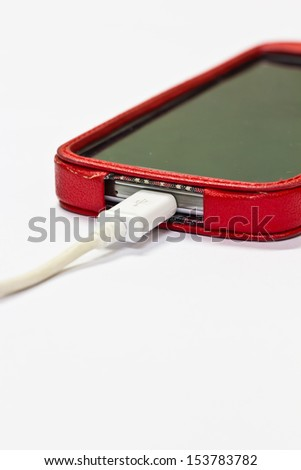 Charging mobile phone isolated on white background - stock photo