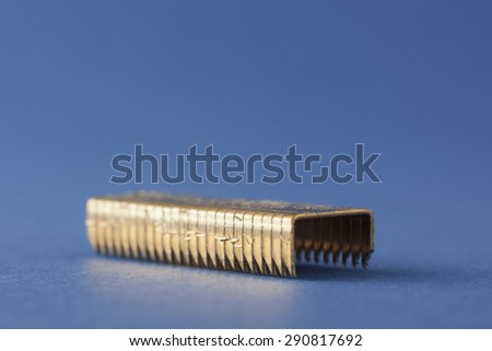 Charging points for nail gun isolated on blue background - stock photo