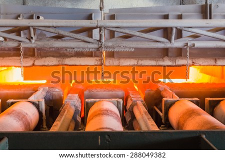 Charging slab in Furnace, In front side Furnace, Industry steel background. - stock photo
