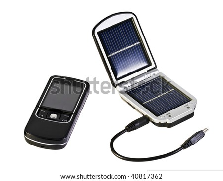 charging solar batteries and a mobile phone - stock photo