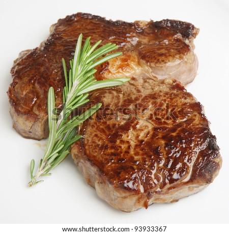 Chargrilled rib-eye beef steak - stock photo