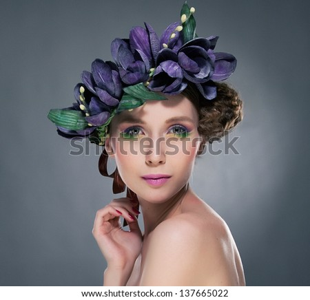 Charisma. Refined Shiny Brunette with Origami Leaves and Paper Flowers. Romance - stock photo