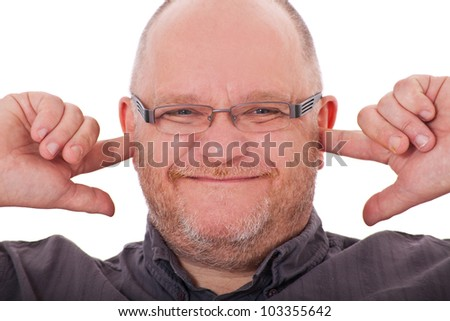 Charismatic adult man keeps his ears shut. All on white background.