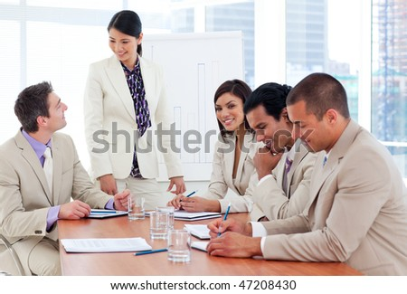Charismatic businesswoman doing a presentation to her team