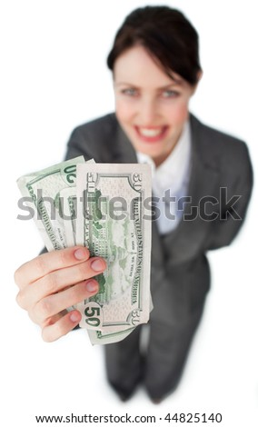 Charismatic businesswoman showing bank notes against a white background - stock photo