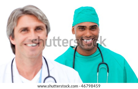 Charismatic male doctors standing in a line against a white background