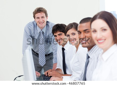Charismatic manager and his team working at computers