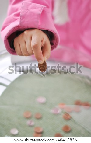 Charity activities, coins under the glass - stock photo
