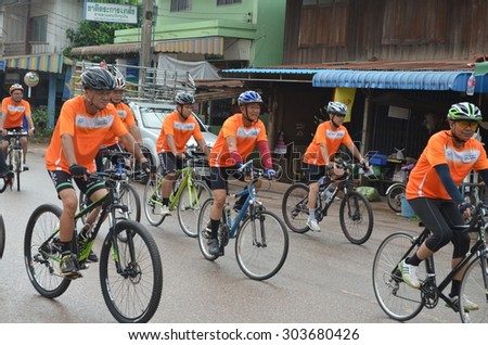 charity bicycle race / PHITSANULOK THAILAND - JUNE 26: Cyclists compete in Nakornthai charity bicycle race  in Nakornthai Phitsanulok,Thailand on June 26, 2015. - stock photo