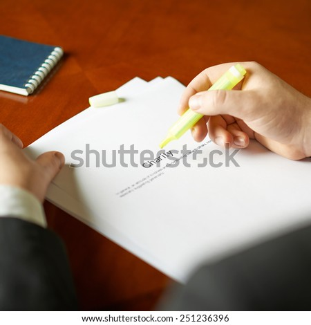 Charity definition as a shallow depth of field close-up composition of a man in a business suit working with the text