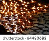 Charity. Lignting of Praying candles in a temple. - stock photo