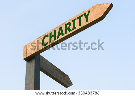 CHARITY word on wood roadsign