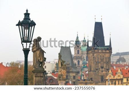 Charles bridge across Vltava river in cloudy autumn day, Prague, Czech Republic - stock photo