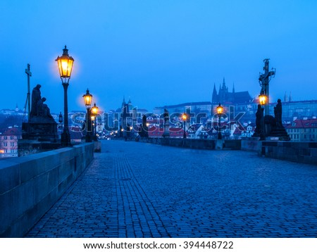 Charles Bridge and Prague Castle before sunrise - stock photo