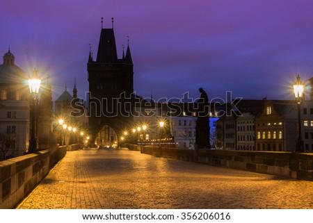 Charles Bridge and Prague Castle in Prague (Czech Republic) at night lighting. - stock photo