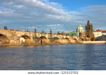 Charles bridge in Prague, in a afternoon sunset scene