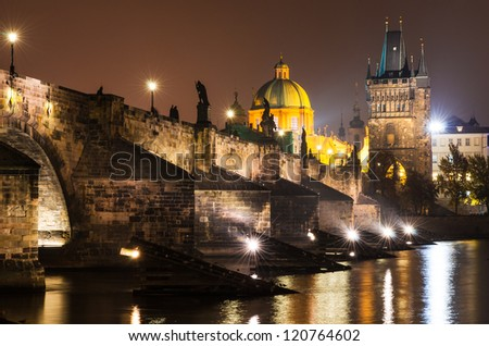 Charles Bridge (Karluv Most) is Prague�¢??s most familiar monument, connects the Old Town (Stare Mesto) with the Little Quarter (Mala Strana). Although it is now pedestrianized. - stock photo