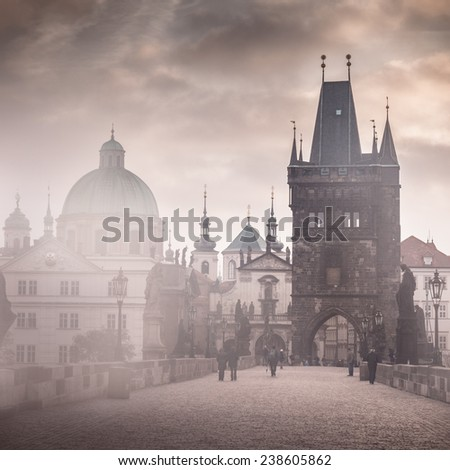 Charles Bridge misty morning in Prague