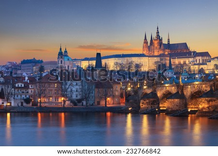 Charles Bridge Prague scenery over river at dusk - stock photo