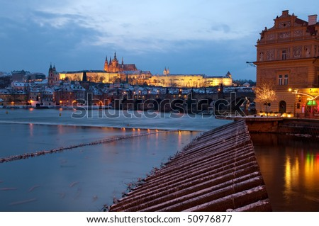 Charles bridge, Saint Vitus cathedral and president palace seen from Vltava riverside, Czech republic - stock photo
