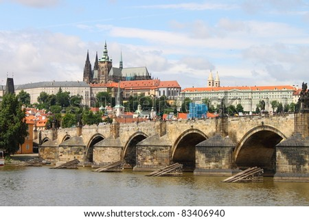 Charles Bridge with Prague castle in background - stock photo