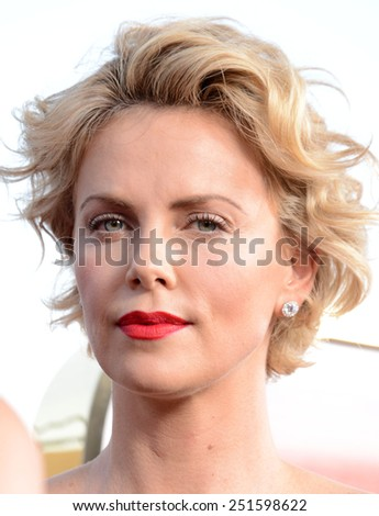 """Charlize Theron at the Los Angeles premiere of """"A Million Ways To Die In The West"""" held at the Regency Village Theatre in Los Angeles, California, United States on May 15, 2014. C - stock photo"""
