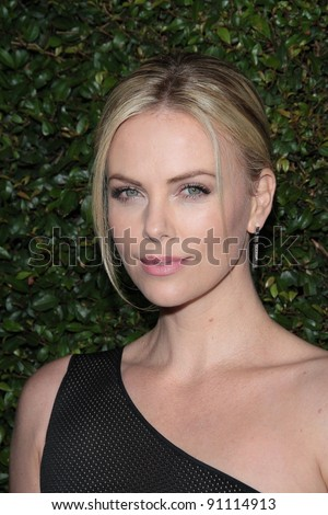 "Charlize Theron at the ""Young Adult"" Los Angeles Premiere, Samuel Goldwyn Theater, Beverly Hills, CA 12-15-11 - stock photo"