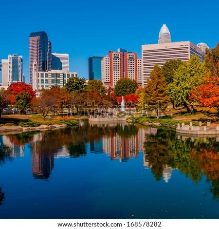 charlotte city skyline from marshll park autumn season with blue sky - stock photo
