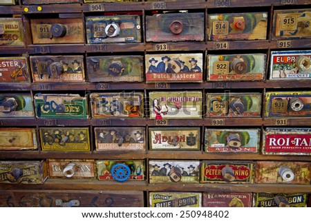 CHARLOTTE, NC - FEBRUARY 7, 2015:  Antique store cabinet with cigar advertising for sale at the Metrolina Expo Antique Show.