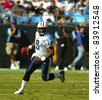 Charlotte, NC - October 19, 2003:  Tennessee Titans Quarterback, Steve McNair, takes his team to victory over the undefeated, Carolina Panthers, at Ericsson Stadiium in Charlotte, NC on Oct 19, 2003. - stock photo