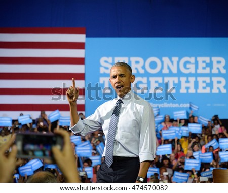 CHARLOTTE, NC, USA - JULY 5, 2016: President Barack Obama arrives on stage at a joint campaign rally for Hillary Clinton at the Charlotte Convention Center.